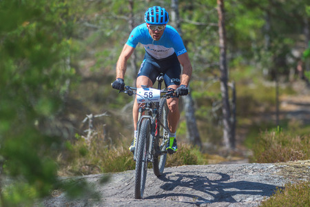 mountainbike: TULLINGE, SWEDEN - JUNE 12, 2016: Mountainbike cyclist in the forest at Lida loop. One of swedens biggest mountainbike races. Editorial