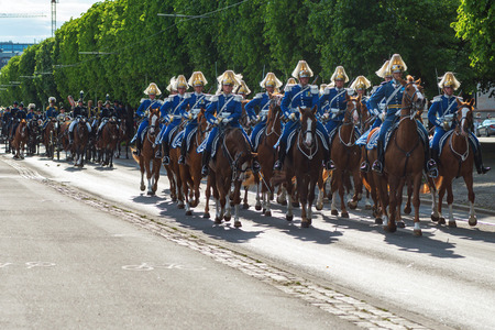 STOCKHOLM, SWEDEN - JUNE 6, 2016: Royal cortege with mounted guards and music corps. Swedish Royalty on the way to Skansen.