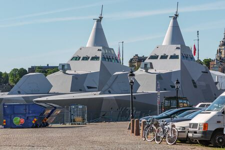 STOCKHOLM, SWEDEN - JUNE 6, 2016: Two military stealth corvettes in the Visby class embarked in Stockholm. HMS Helsingborgin front. Editorial