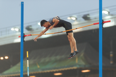 STOCKHOLM, SWEDEN - JUNE 16, 2016: Bokai Huang in the mens pole vault at the IAAF Diamond League in Stockholm.