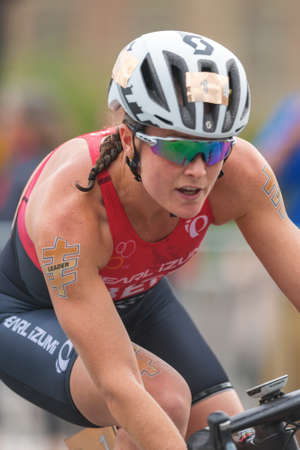 ber: STOCKHOLM, SWEDEN - JULY 02, 2016: Closeup of Flora Duffy (BER) cycling in the lead at the Women ITU Triathlon event in Stockholm. She also won the competition. Editorial