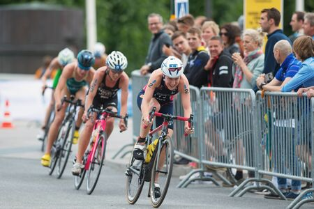 rival rivals rivalry season: STOCKHOLM, SWEDEN - JULY 02, 2016: Jodie Stimpson (GBR) leading a group in the cycling at the Women ITU Triathlon event in Stockholm.
