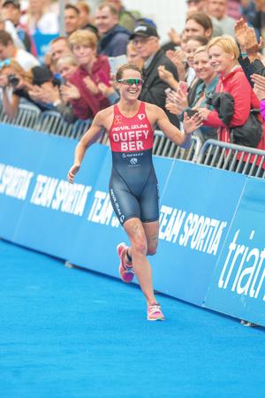 ber: STOCKHOLM, SWEDEN - JULY 02, 2016: Happy Flora Duffy (BER) at the last 100 meters in the Women ITU Triathlon event in Stockholm. Winner 2016 Editorial