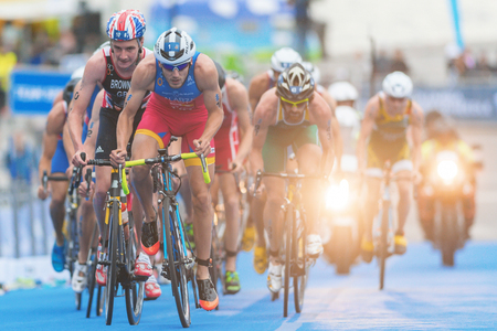 esp: STOCKHOLM, SWEDEN - JULY 02, 2016: Fernando Alarza (ESP) in front of Alistair Brownlee in the cycling at the Mens ITU Triathlon event in Stockholm.