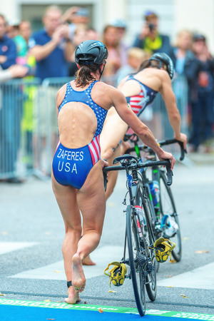 transition: STOCKHOLM, SWEDEN - JULY 02, 2016: Katie Zaferes (USA) in transition between swimming and cycling at the Women ITU Triathlon event in Stockholm.