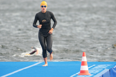 ponton: STOCKHOLM, SWEDEN - JULY 02, 2016: Warmup before the start at Women ITU Triathlon event in Stockholm. Editorial