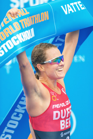 ber: STOCKHOLM, SWEDEN - JULY 02, 2016: The winner Flora Duffy (BER) crossing the finish line at the Women ITU Triathlon event in Stockholm. Editorial