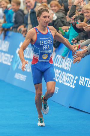pierre: STOCKHOLM, SWEDEN - JULY 02, 2016: Pierre Le Corre (FRA) clapping hands at the finish in the Mens ITU Triathlon event in Stockholm. Le Corre placed third in this event.