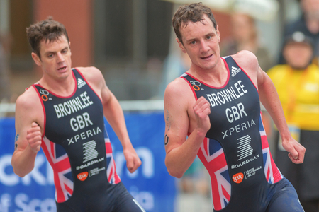 STOCKHOLM, SWEDEN - JULY 02, 2016: Brownlee brothers in a curve running at the Mens ITU Triathlon event in Stockholm. Alistair first and in focus.