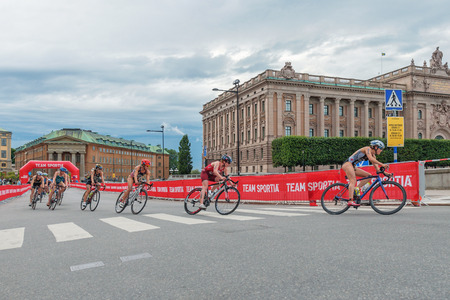 rivals rival rivalry season: STOCKHOLM, SWEDEN - JULY 02, 2016: Group of cyclists in wide angle view at the Women ITU Triathlon event in Stockholm.