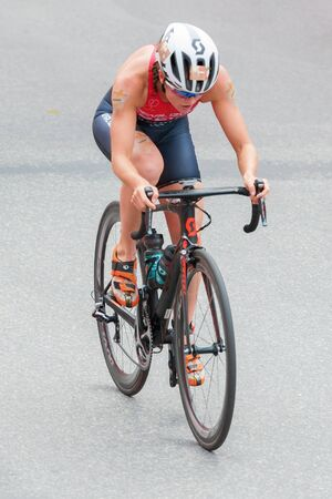 ber: STOCKHOLM, SWEDEN - JULY 02, 2016: Leader Flora Duffy (BER) from above cycling at the Women ITU Triathlon event in Stockholm.
