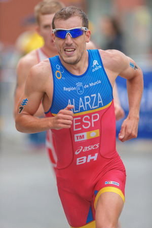 esp: STOCKHOLM, SWEDEN - JULY 02, 2016: Fernando Alarza (ESP) the overall leader running at the Mens ITU Triathlon event in Stockholm.
