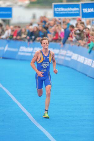 gabriel: STOCKHOLM, SWEDEN - JULY 02, 2016: Gabriel Sandor to the finish area at the Mens ITU Triathlon event in Stockholm.