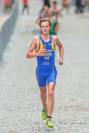 gabriel: STOCKHOLM, SWEDEN - JULY 02, 2016: Gabriel Sandor running at the cobblestones in the old town at the Mens ITU Triathlon event in Stockholm. Editorial