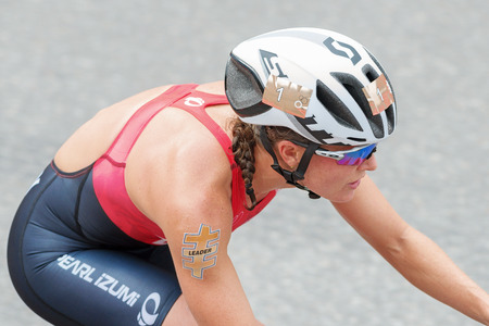 rival rivals rivalry season: STOCKHOLM, SWEDEN - JULY 02, 2016: Closeup of leader Flora Duffy (BER) from above cycling at the Women ITU Triathlon event in Stockholm. Editorial
