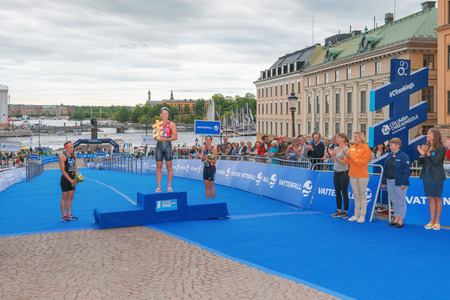 helen: STOCKHOLM, SWEDEN - JULY 02, 2016: Winner Flora Duffy (NZL), second Andrea Hewitt (NZL) and third Helen Jenkins (GBR) at the podium and prize cermony at the Women ITU Triathlon event in Stockholm. Editorial