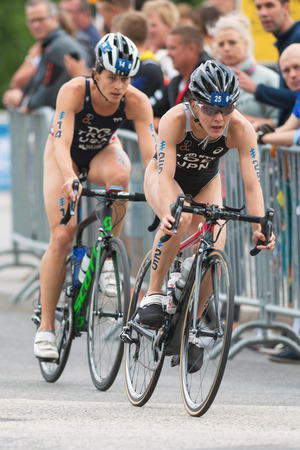 ide: STOCKHOLM, SWEDEN - JULY 02, 2016: Juri Ide (JPN) infront of Sarah True (USA) in the cycling at the Women ITU Triathlon event in Stockholm.