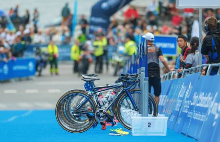 transition: STOCKHOLM, SWEDEN - JULY 02, 2016: Bikestands in the transition between cycling and running at the Women ITU Triathlon event in Stockholm.