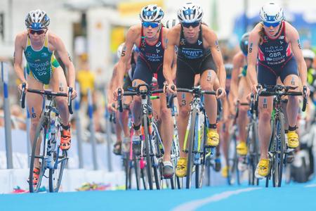 rivals rival rivalry season: STOCKHOLM, SWEDEN - JULY 02, 2016: Group of cyclists at the last lap before the transition between cycling and running at the Women ITU Triathlon event in Stockholm.