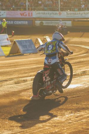 samuel: HALLSTAVIK, SWEDEN - JULY 19, 2016: Samuel Masters (Lejonen) in warm sunlight at the speedway competition between Rospiggarna and Lejonen at HZ Bygg Arena in Hallstavik. Editorial