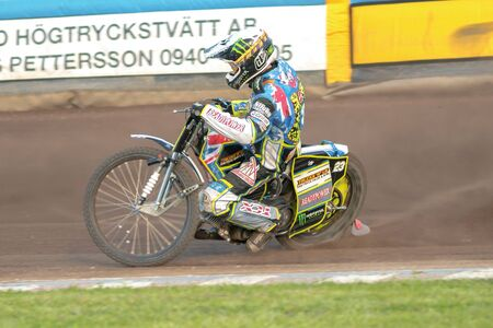 HALLSTAVIK, SWEDEN - JULY 19, 2016: Speedway raciner into the first curve between Rospiggarna and Lejonen at HZ Bygg Arena in Hallstavik.