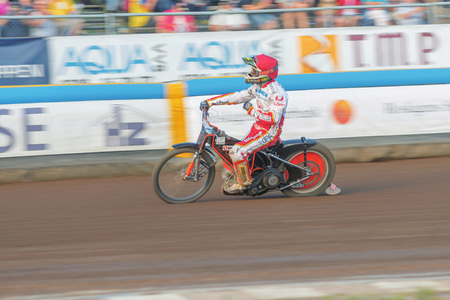 HALLSTAVIK, SWEDEN - JULY 19, 2016: Speedway racing in motion blur between Rospiggarna and Lejonen at HZ Bygg Arena in Hallstavik.