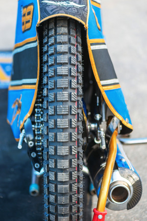 HALLSTAVIK, SWEDEN - JULY 19, 2016: Back wheels of the speedway racers between Rospiggarna and Lejonen at HZ Bygg Arena in Hallstavik. Editorial