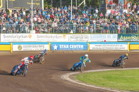 HALLSTAVIK, SWEDEN - JULY 19, 2016: Speedway racing between Rospiggarna and Lejonen at HZ Bygg Arena in Hallstavik.