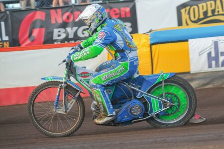 HALLSTAVIK, SWEDEN - JULY 19, 2016: Speedway racing between Rospiggarna and Lejonen at HZ Bygg Arena in Hallstavik.