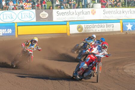 HALLSTAVIK, SWEDEN - JULY 19, 2016: Speedway racers in the second curve between Rospiggarna and Lejonen at HZ Bygg Arena in Hallstavik.