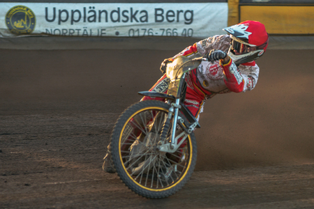 HALLSTAVIK, SWEDEN - JULY 19, 2016: Closeup of a speedway racer between Rospiggarna and Lejonen at HZ Bygg Arena in Hallstavik. Editorial