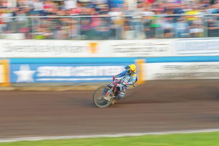 HALLSTAVIK, SWEDEN - JULY 19, 2016: Speedway racing in motion blur between Rospiggarna and Lejonen at HZ Bygg Arena in Hallstavik.