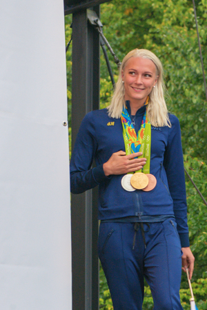 entertaiment: STOCKHOLM, SWEDEN - AUG 21, 2016: Olympic medalists from Rio are celebrated in Kungstradgarden. Swimmer Sarah Sjostrom, Gold, silver and bronze