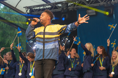 celebrated: STOCKHOLM, SWEDEN - AUG 21, 2016: Olympic medalists from Rio are celebrated in Kungstradgarden. Entertaind by John Lundvik