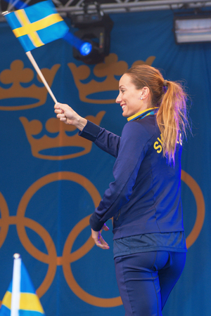 entertaiment: STOCKHOLM, SWEDEN - AUG 21, 2016: Olympic medalists from Rio are celebrated in Kungstradgarden. Soccerplayer Kosovare Asllani Editorial