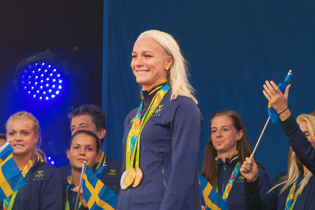 celebrated: STOCKHOLM, SWEDEN - AUG 21, 2016: Olympic medalists from Rio are celebrated in Kungstradgarden. Swimmer Sarah Sjostrom, Gold, silver and bronze