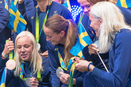 celebrated: STOCKHOLM, SWEDEN - AUG 21, 2016: Olympic medalists from Rio are celebrated in Kungstradgarden. Sjostrom shows the soccer team her medals