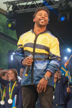 STOCKHOLM, SWEDEN - AUG 21, 2016: Olympic medalists from Rio are celebrated in Kungstradgarden. Entertaind by John Lundvik