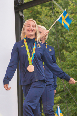 STOCKHOLM, SWEDEN - AUG 21, 2016: Olympic medalists from Rio are celebrated in Kungstradgarden. Wrestling bronze medalists Mattson and Fransson
