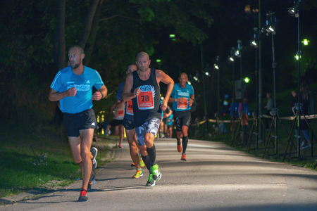elite: STOCKHOLM, SWEDEN - AUG 13, 2016: Elite runners at the Midnight run in Stockholm (Midnattsloppet). A public event yearly in city areas.