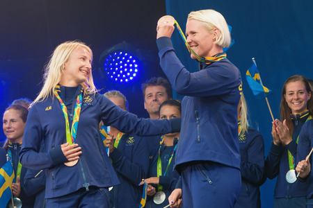 celebrated: STOCKHOLM, SWEDEN - AUG 21, 2016: Olympic medalists from Rio are celebrated in Kungstradgarden. Wrestling bronze medalists Mattson and Fransson