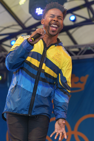 entertaiment: STOCKHOLM, SWEDEN - AUG 21, 2016: Olympic medalists from Rio are celebrated in Kungstradgarden. Entertaind by John Lundvik