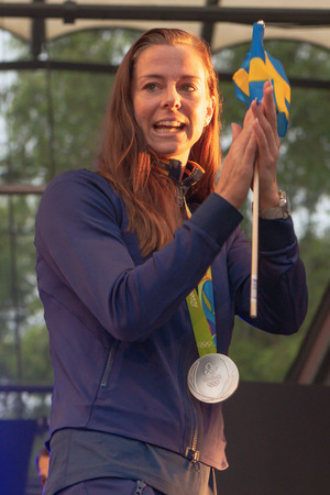entertaiment: STOCKHOLM, SWEDEN - AUG 21, 2016: Olympic medalists from Rio are celebrated in Kungstradgarden. Soccerplayer Lotta Schelin Editorial