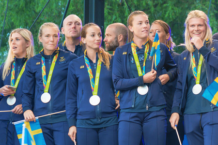 celebrated: STOCKHOLM, SWEDEN - AUG 21, 2016: Olympic medalists from Rio are celebrated in Kungstradgarden. Soccer players