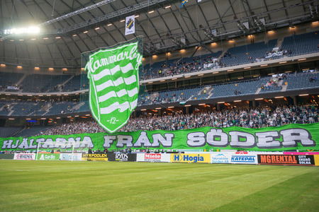solna: SOLNA, SWEDEN - AUG 28, 2016: Soccer derby between AIK and Hammarby in Allsvenskan at Friends arena. Visibility due to smoke wasnt that good the first half.