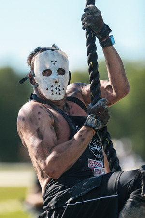 STOCKHOLM, SWEDEN - AUG 27, 2016: Scary man with Jason mask at the Rope climb at the Tough Viking event at Gardet in Stockholm.