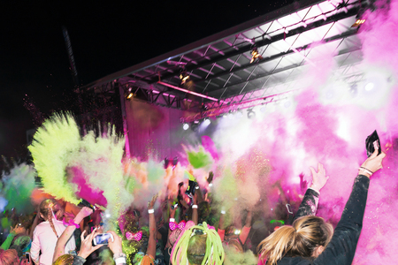 after midnight: STOCKHOLM, SWEDEN - SEPT 18, 2016: Crowd throws color powder at the Color Run Night Edition in Stockholm. Editorial