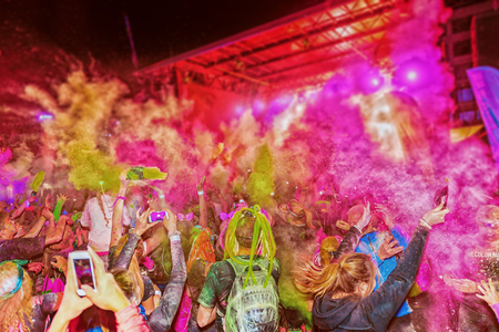 after midnight: STOCKHOLM, SWEDEN - SEPT 18, 2016: Crowd throws color powder at the Color Run Night Edition in Stockholm. Throw of color powder and very detailed Editorial