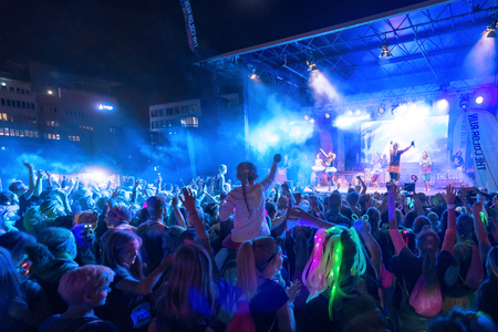 after midnight: STOCKHOLM, SWEDEN - SEPT 18, 2016: Bright colorful stage with crowd in front at the Color Run Night Edition in Stockholm.