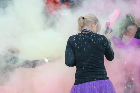 STOCKHOLM, SWEDEN - SEPT 18, 2016: Colorful happy people throw color powder at the Color Run Night Edition in Stockholm. Editorial